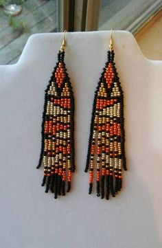 This Native American Style Rattle Snake is Custom made one bead at a time by Elaine. Ready to wear GREAT GIFT. These are made with Many Colors of Seed Beads they are 4 inch long with Gold plated ear wires on them. All ear wires can be changed to post or clips and leaver backs. If