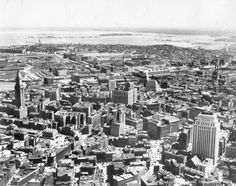 Scollay Square aerial - June 1940, shows Boston about a year and half before U.S. entered WW2.  In upper left, Fan Pier is still mostly rail yards.  In the city proper only the Custom House and the 1939 Courthouse in Pemberton Square dent the skyline, and already signs of decay are evident in Scollay Sq. (lower right) as several buildings had been torn down and the lots used for parking.