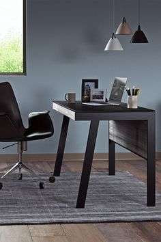 Ideal for smaller spaces, the Sigma Compact Desk by BDI is the perfect choice if you want a modern option that includes all the bells and whistles. It comes with a keyboard drawer, cable management, and durable tempered glass that resists scratches. Designed by Matthew Weatherly, this contemporary desk is a versatile, sleek option for a modern home office or bedroom.