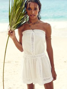 Breezy does it: this lightweight beach cover-up has Coachella written all over it with boho crochet, ruffles and hot-now fringe. | Victoria's Secret Fringed Cover-up