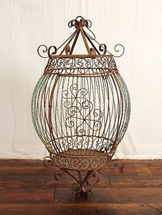 vintage birdcage - candlelight would make wonderful patterns on the walls