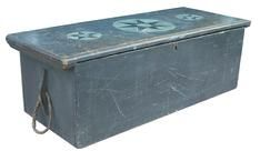 """Sailors took a pride in their sea-chests, often painting a picture of a ship inside the lid and fitting them with strong ornamental rope handles. This Seaman Chest has three stars painted on top on a pewter gray back ground  and two ships painted on the inside of the lid. six board chest with rose head  nail construction.  circa 1790.   Measurements are: 16"""" deep x 40 1/2"""" long x 13"""" tall"""