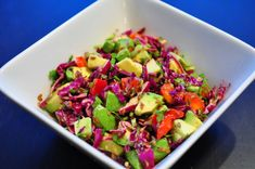 PALEO AVOCADO SLAW 6 cups of shredded purple and green cabbage 3 tablespoons of chopped red onion 3 tablespoons cilantro leaves 2 tables spoons lime juice 2 ripe avocados 1/4 cup of sesame seeds