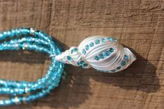 Beautiful Three stranded Blue, Teal and White with a Seashell Pendant! on Etsy, $15.50