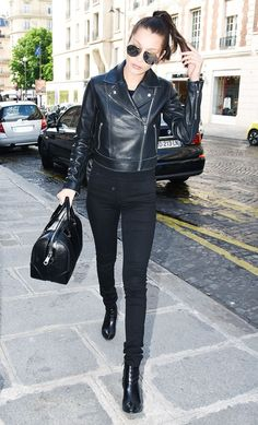 bella hadid wears a black leather jacket black jeans black boots and a givenchy bag