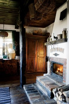 kitchen fireplace in a century old cabin in poland | interior design + decorating ideas