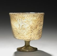 Stemmed Cup, 500s-600s      Syro-Palestinian, 6th-7th century      glass, Overall - h:8.00 w:7.20 cm (h:3 1/8 w:2 13/16 inches) Diameter of foot - w:4.30 cm (w:1 11/16 inches).