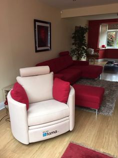 Electric recliner, in cream fabric with red contrast arm cushions to complement the red sofas/footstool.