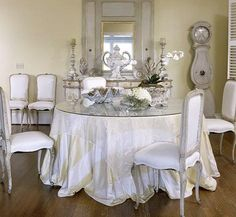 A French mirror and antique Swedish clock blend with the light palette of the dining room. - Traditional Home ® / Photo: Emily Minton Redfield / Design: Mimi Williams White Dining Room Chairs, Dining Decor, Dining Area, Dining Rooms, Swedish Interior Design, Swedish Interiors, Traditional Design, Traditional House, Traditional Home Magazine