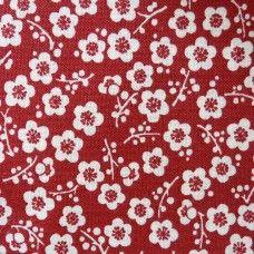 Tissu rouge fleurs de prunier blanches