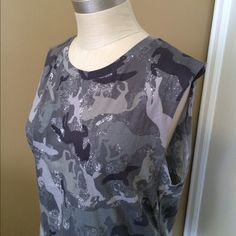 """horse print camo tee okay, so i was torn all to pieces when i found this shirt on poshmark! camo?!?! with HORSES?!?!? """"is this blouse still available?!?"""" i begged the posh seller. yes! i giddy-up-ily purchased it, only to have it arrive and be too small. what can i say? i am a clydesdale in a pony world. (25"""" long, 20"""" from underarm to underarm, 100% cotton) Divided Tops Tees - Short Sleeve"""