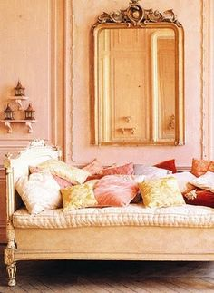 Daybed, love.  Mirror, beautiful.  Get rid of all the pillows.