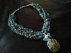 Beautiful one of a kind Multi strand turquoise necklace and spiny oyster shell with a handmade wire wrapped turquoise pendent. Up for bids starting at a wholesale price $250