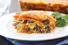 Stacked roasted veggie enchiladas.