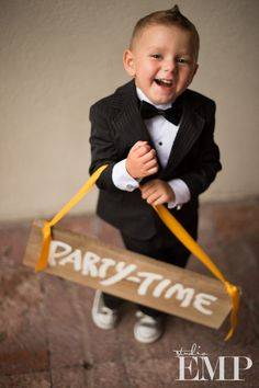 """Punk ring bearer with """"Party Time"""" sign 