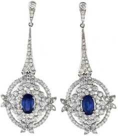 Sapphire and diamond earrings. Total estimated sapphire weight, 3.70 carats; diamonds, 2.70 carats. Mounted in white gold. Via Diamonds in the Library.