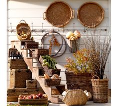 Daytrip Lidded Baskets | Pottery Barn - rattan basket.     Made of handwoven split malacca and natural rattan.     Iron sheet metal with a bronze finish.