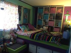 My 8 year old daughters custom raised up bed! Underneath built in dresser, stairs and wall box shelves