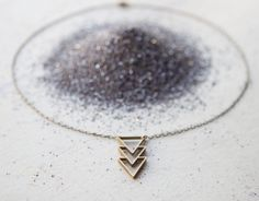 the Triple Triangle necklace. $42.00, via Etsy.