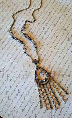 Antique Bronze Rhinestone Chandelier Necklace ~ Peach Chandelier Necklace ~ Antique Bronze Sweater Necklace ~ Bronze Peach Tassel Necklace by MissGawdysJewelry on Etsy https://www.etsy.com/listing/265727533/antique-bronze-rhinestone-chandelier