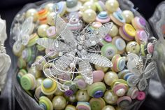 Wedding bouquets made from steel wire and buttons. Great idea to save cost and really original.