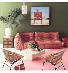 Tropicana inspired. Those chairs and that sofa!!!