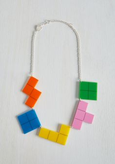Settle the High Score Necklace. We know that clever accessorizing isnt a contest, but if it were, youd take home the top prize every time with this statement necklace from Tatty Devine! #multi #modcloth
