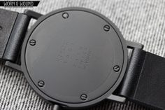 Stock Watch S001K. Back plate with debossed detail text and screws.