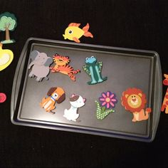 Magnet board for kids in the car!  Little animals I got at Michaels for $0.50 and got a new pan at Walmart for $5 then glued $3magnets to the back of the animals I attached a sticky dry erase sheet to the back for reversible fun! See my next pin for the reverse pic!