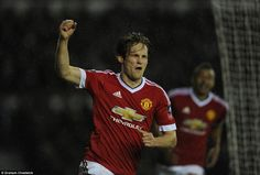 Blind celebrates scoring the goal that effectively sealed United's progress into the fifth...
