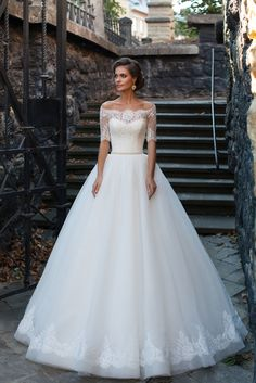 Dalila - Delicate Pearl - MillaNova Incomparable magnificent wedding dress decorated with exclusive Shantilier lace and luxury European mesh Hayal. Off-the-shoulder corset and lacy bolero decorated with handmade belt embellished with jewels, gems and beads.