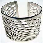Op Dot - Pierced Sterling Silver Cuff by Gordon W Roberston, £350. Available at SeekandAdore.com