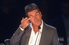 Simon Cowell flipping the bird
