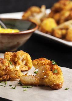 Pan Fried Spanish Cauliflower Tapas - These breaded fried cauliflower bites are a simple and tasty tapas dish you should make at your next get-together! Just a quick dunking in egg and breadcrumbs and a minute in a skillet and you are all done. Can be made ahead and reheated!   justalittlebitofbacon.com