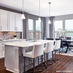 Open, spacious, and inviting. With our open concept kitchens hosting guests has never been easier. | Pulte Homes