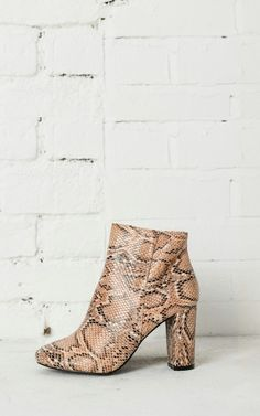 These chunky heeled faux python-effect boots are just the right amount of sass you need to make a mini statement this season.