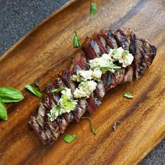 A pan-seared rare New York Strip steak with blue cheese mustard butter. High protein, low carb, and delicious.