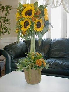 Sunflower topiary with mixed fall flowers