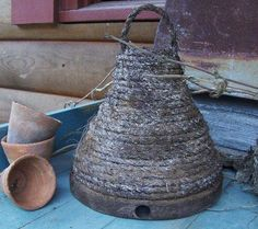 *This looks like it is made with 2 flower pots glued together and wound with rope of some kind.