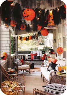 Halloween garland made from black netting (or fancier tulle) paper lanterns on a string of lights.  Makes for a fun Halloween porch
