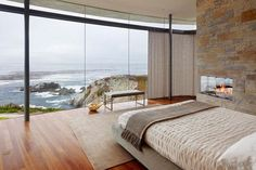 Themed Bedroom Minimalist Bedroom With Floor To Ceiling Glass Windows With Amazing Rocky Coastline Also Modern Fireplace Built In Brick Wall And Wooden Floor Create Natural Decor 10 Contemporary Bedroom Ideas with Beautiful Ocean View Awesome Bedrooms, Beautiful Bedrooms, Beautiful Homes, Beautiful Ocean, House Beautiful, Bedroom Fireplace, Fireplace Design, Modern Fireplace, Small Fireplace