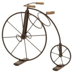 Refresh your well-dressed home for summer with this eye-catching essential, offering style and flair for enviable appeal.  Product: Bicycle wine rackConstruction Material: MetalColor: BronzeDimensions: 15 H x 17 W x 9 DCleaning and Care: Wipe with dry cloth