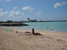 Hickam AFB Beach, Joint base Pearl Harbor Hickam, HI OMG  it is awesome to swim in the ocean and watch the planes take off :D