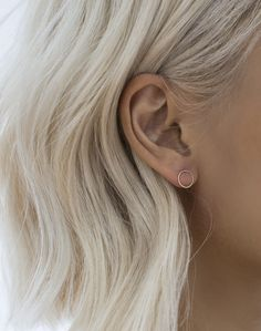 Super airy and delicate 'O' shaped earrings made of spun golden wire. On the ear lobe, it gives the appearance of 'transparency'.   A part of La Minimaliste Collection We recommend layering this with either the 'Bey' Honeycombs or the Mini 'Strip' Earring.
