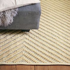 I love the Chevron Knot Rug - Ivory on westelm.com    85% wool/15% cotton;  $149 - $799.  runner to 9 x 12.