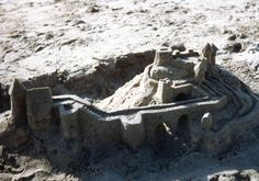 A sandcastle with lots of stairs.