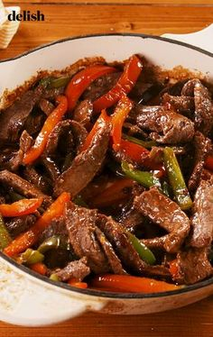 Pepper Steak beats takeout any night of the week. Get the recipe at Delish.com #recipe #easy #easyrecipes #delish #pepper #steak #meat #beef #vegetables #veggies #dinner #easydinner #takeout #chinese #rice