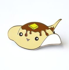 Meet+Flapjack,+the+pancake+stingray!+Flapjack+is+a+super+adorable+hard+enamel+pin.+Wear+him+with+your+outfit,+or+add+him+to+your+pin+board! Size:+38.1+mm+/+1.5+inches+wide+by+19.8+mm+/+.8+inches+high+ Plating:+Gold+ HARD+ENAMEL+ 2+posts+on+back+with+black+rubber+clasps+ Comes+on+cute+backi...