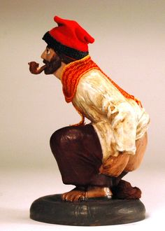 El Caganer - The crapper figure is nearly always depicted with the Catalan red cap called a Berretina