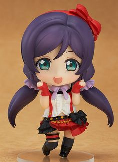"""**""""How Spiritual!♪""""**  From the popular anime series 'LoveLive!' comes a Nendoroid of the spiritual girl who takes things at her own pace, Nozomi Tojo! She has been sculpted wearing her outfit used in the song 'Bokura wa Ima no Naka de'. Nozomi comes with both a friendly smiling expression as well as a mischievous grin to choose from. Special arm parts are also included to display her ready to ..."""